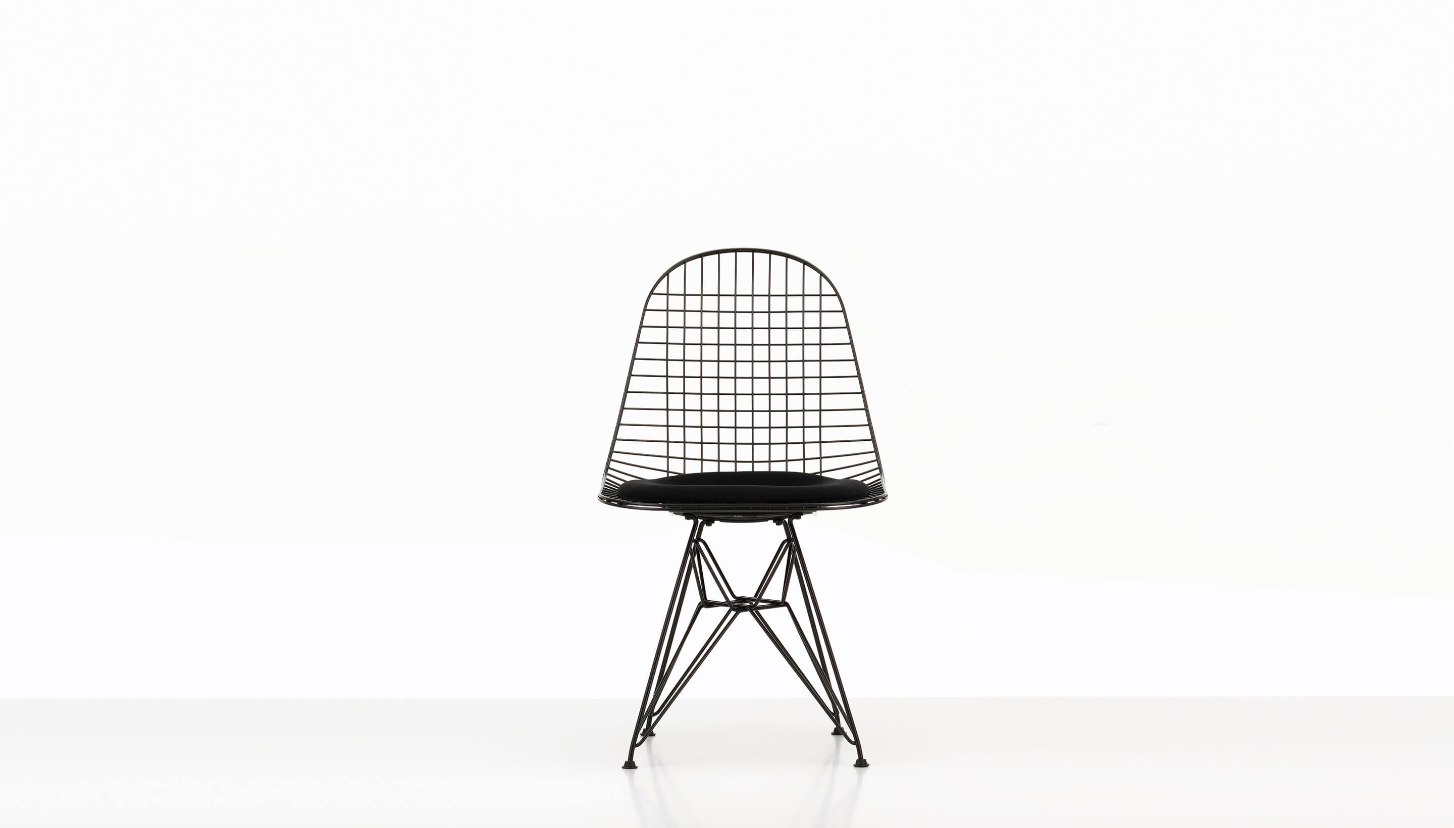 herman wire chair eames dkr with seat miller living chairs pad